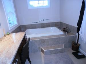 Jetted Bathtub in New Tiled Bathroom Long Island
